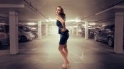 Woman poses in parking garage