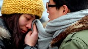 "A woman wipes her tears with her partner's scarf as they part at Beijing west railway station, January 19, 2012. Chinese New Year, or Spring Festival, is the biggest of two ""Golden Week"" holidays, giving migrant workers their only chance of the year to return to their home provinces with gifts for their families. More than 200 million people are expected to take to the railways over this year's holiday, the biggest movement of humanity in the world. 